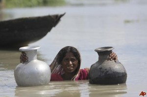 The individuals behind the climate change headlines. Flooding in India, 2009.